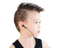 Boy with headphones. Young boy with headphones, portrait in profile Stock Images
