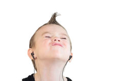Boy with headphones. Young boy with headphones, on white background Stock Photo