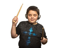 Boy with headphones and drumsticks Royalty Free Stock Image