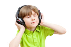 The boy in the headphones enjoy music Royalty Free Stock Photos
