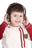 Boy in headphones listen music. Royalty Free Stock Photo