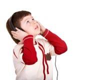Boy in headphones listen music. Stock Photos