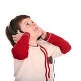 Boy in headphones listen music. Stock Image