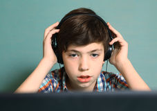boy with headphones listen to popular music royalty free stock photo