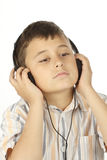 Boy with headphones listening to music Stock Image