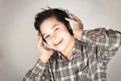 Boy with headphones. Boy listening to music with headphones Stock Image