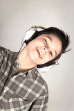 Boy with headphones. Boy listening to music with headphones Royalty Free Stock Photos