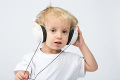 Boy with headphones listening to music Stock Photography