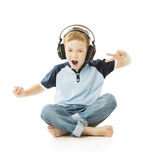 Boy headphones listening to music and singing. Child isolated over white background Royalty Free Stock Image