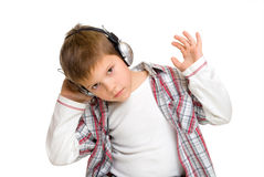 Boy in headphones listens to music Stock Images