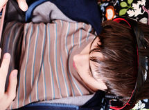 Boy with headphones looks on the tablet. Gadgets, Internet addiction, music Stock Images