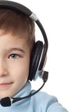 Boy in headphones with microphone. Over white background Royalty Free Stock Image