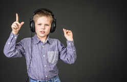 Boy in headphones. Music. Stock Images