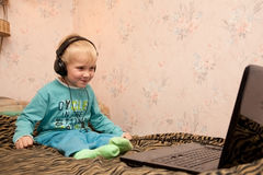 Boy in headphones with notebook Royalty Free Stock Image