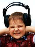 Boy in headphones screaming with eyes closed on white background.  royalty free stock photos