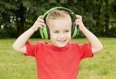 Boy in headphones summer smiling Stock Photography