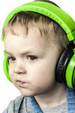Boy and headphones Stock Images
