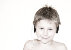 Boy with headset. Young boy with headset on white background stock image