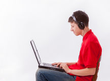 Boy with headset and laptop Royalty Free Stock Photography