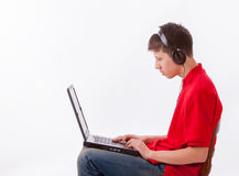 Boy with headset and laptop Stock Photos
