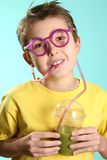 Boy with a healthy superjuice Royalty Free Stock Photography