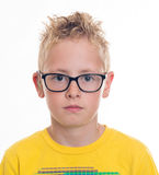 Boy with hearing aid and glasses. Blond boy with hearing aid and glasses Stock Photography