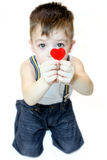 Boy with heart. Small boy with red heart on white background Stock Photo
