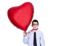 Boy with heart balloon Royalty Free Stock Photo