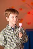 Boy with a heart in his hands Royalty Free Stock Photo