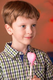 Boy with a heart in his hands Stock Photo