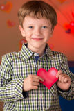 Boy with a heart in his hands Royalty Free Stock Photos