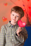 Boy with a heart in his hands Royalty Free Stock Image