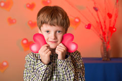 Boy with a heart in his hands Stock Image