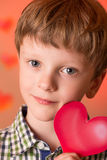Boy with a heart in his hands Royalty Free Stock Photography