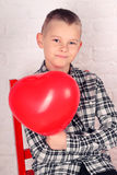Boy with a heart shaped balloon Royalty Free Stock Images