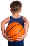 The boy held a basketball ball behind the back Royalty Free Stock Photos