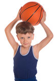 Boy held a basketball ball over a head Stock Photography