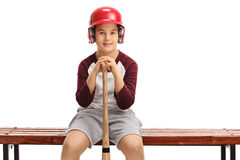 Boy with a helmet and a baseball bat sitting on a bench. Isolated on white background Royalty Free Stock Image