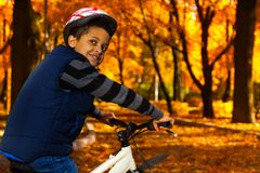 Boy in helmet on the bike Stock Photo