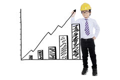 Boy with helmet drawing financial graph Stock Images