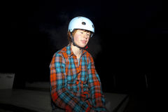 Boy with helmet by night Royalty Free Stock Photography