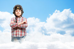 Boy in helmet pilot dreaming of becoming a pilot Royalty Free Stock Photos