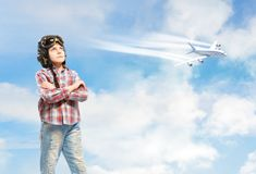 Boy in helmet pilot dreaming of becoming a pilot Stock Photos