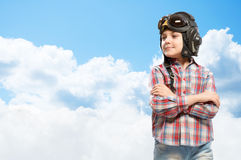 Boy in helmet pilot dreaming of becoming a pilot Stock Photo