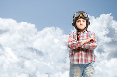 Boy in helmet pilot dreaming of becoming a pilot Stock Photography