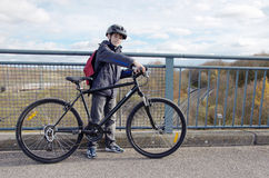 Boy with helmet riding bicycle Royalty Free Stock Photos