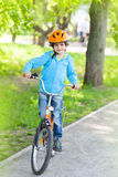 The boy in the helmet riding a Bicycle Stock Photography