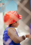 Boy with helmet roleplay construction worker. At school Stock Images