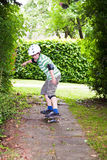 Boy with helmet is scateboarding Stock Photography