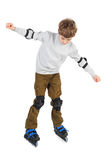Boy in helmet with at sides and rollerblading Stock Image